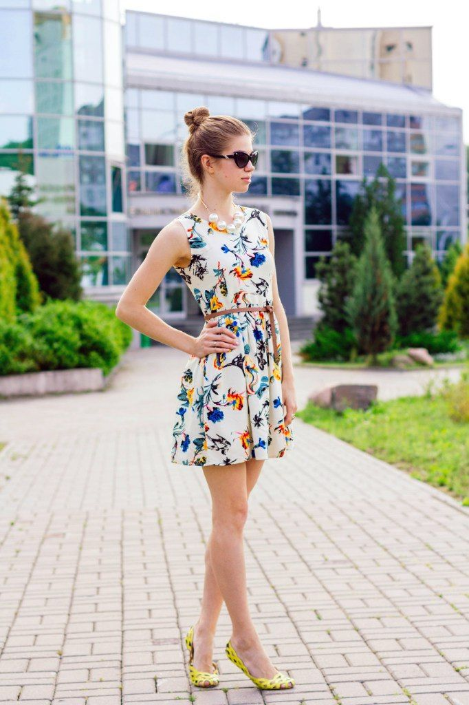colourful white floral dress with yellow shoes